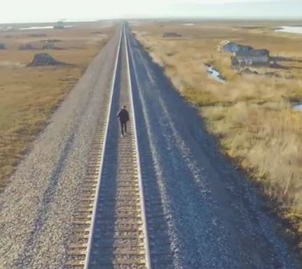 walking alone on the train tracks